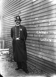 African American police officer in the St. Paul Police Department.  St Paul, Minnesota.  ca 1900