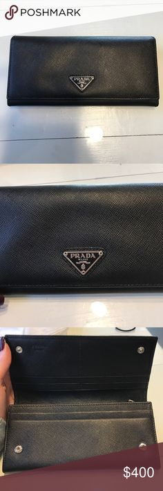 Authentic Prada wallet Like brand new!!! Mint condition flap over with zipper inside. Authentic Prada wallet Prada Bags Wallets