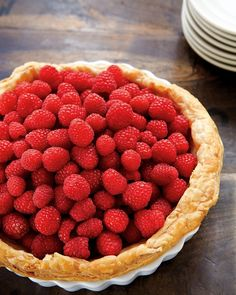 Raspberry Custard Tart Recipe. Tip: The berries should look as though they have simply tumbled onto the tart, so don't be fussy when arranging them on the custard filling.