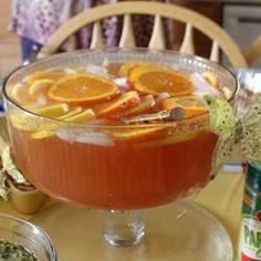 Punch  slice 2 lemons, 3 oranges into bowl. add 1 6oz can lemonade concentrate, 1 liter club soda, 2 bottles sparkling cider, 1 T sugar and ice.  Serve.