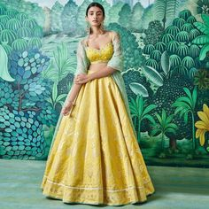 The muted yellow Prianka Lehenga catches the sunlight on its gold foil print and splays it all around in a warm festive glow. Indian Attire, Indian Ethnic Wear, Indian Dresses, Indian Outfits, Indian Clothes, Emo Outfits, Bridal Lehenga, Red Lehenga, Indian Wedding Lehenga