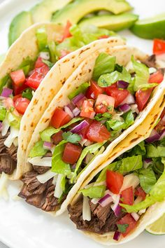 Slow Cooker Barbacoa Beef Tacos (Chipotle Copycat) - this beef is so tender and delicious!! I'll definitely make these again!