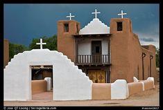 San Geronimo church under dark sky. Taos, New Mexico, USA (color)