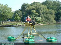 Nothing is cooler than a one man redneck pontoon boat made out of old plastic barrels! ...