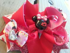 Minnie Love ~ approximately 5 inches ~ Wild About Minnie Bow ~ Aproximately 5 inches ~ Adorned with lots of prints, sparkle, and crystals  ~ Hand made with love, top quality materials and exceptional craftsmanship ~ To see more visit www.facebook.com/BizzyBodiesBowBoutique