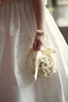 If your flower girl is too tiny to drop petals, you may wanna go with a wishing ball. The~Lil~Things can custom make flower girl accessories.