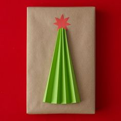 Decorate a Box With a Tree Cut a wide triangle out of green construction paper. Fold it in accordion pleats, radiating from top point. Cut a star out of red paper. Use double-sided tape to affix tree and star to box. Gift Wrapping Ideas - ALL YOU Christmas Time Is Here, Christmas Art, Christmas Projects, Creative Gift Wrapping, Creative Gifts, Wrapping Ideas, Craft Gifts, Diy Gifts, Brown Paper Packages