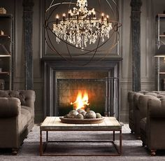 Like this look...dark, rustic.. The light and couches with the fireplace and black molding. Nice.