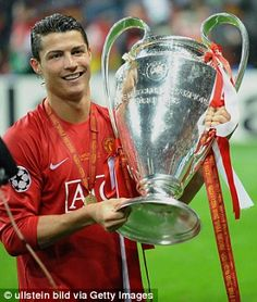 Ronaldo holds the Champions League trophy
