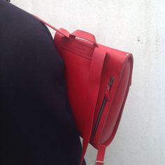 Red leather rucksack by wolfram Lohr