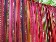 A ribbon backdrop is a great way to add your personal touch to your wedding or other special event. You hang it from trees to let it flow