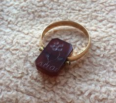 Here is a stunning 18K gold carnelian ring. It is a two sided ring, one side has…