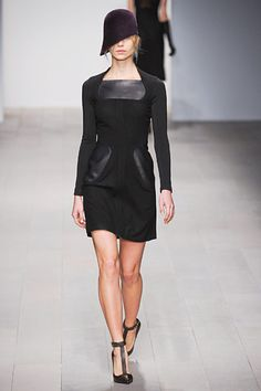 Listen, stick some leather on a dress and chances are I will like it.  #MariosSchwab #LFW