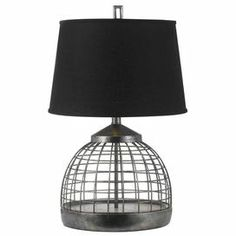 """Openwork metal accent lamp in antiqued pewter with a black linen shade.Product: Accent lamp    Construction Material: Metal and linen    Color: Antique pewter and black   Features:   Handcrafted    Will enhance any decor   Accommodates: (1) 150 Watt  Edison base bulb - not included     Dimensions: 28"""" H x 18"""" Diameter"""
