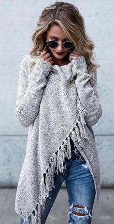 #fall #outfits white poncho and blue distress jeans
