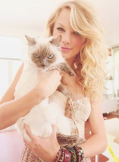 Taylor and her cat. She looks like Meredith, but she could be Olivia.