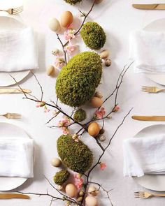 "Give soft green moss an extra-festive update by shaping it into elegant eggs. Arranged with quince branches and blown-out eggs, this collection is a natural Easter centerpiece. See the ""Moss-Egg Centerpiece"" in our gallery Easter Table, Easter Eggs, Diy Ostern, Deco Floral, Easter Brunch, Easter Dinner, Easter Party, Easter Gift, Decoration Table"