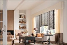 Graber Wooden Vertical Blinds with Cloth Tape.  Living room ideas do include window dressings. Note that the wood blinds are supported bycolor blocked brown / yellow drapes with with a cartridge pleat & also a cornice box / valance. This contrast of light and dark, is carried throughout the great room with the wood coffee table and wood table stand.