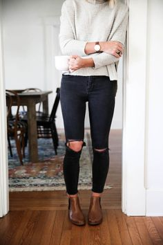 free people arctic fox sweater with chelsea boots and black distressed skinny jeans