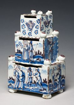 Money Box, Delftware tin-glazed earthenware painted in blue and manganese, height (whole) 23cm, width (whole) 13.2cm, Delft, Holland.