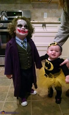 Dena: My two year old daughter Olivia is the Joker and my 8 month old Isabelle is Batman. The costumes was both hand made by my sister in law and the...