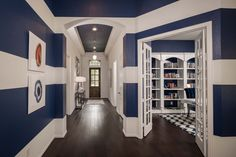 Stylish blue stripes draw visitors into this home's foyer and formal dining room. Harper's Preserve // Houston, TX // Highland Homes Plan 542