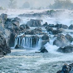 Few places on the East Coast are as lovely as Great Falls at dawn. . At sunrise in early summer the Potomac is a painting in motion -- a misty blur of hues; blues and greens and pinks and oranges swirling together. Great blue herons flock to spear fish from the rocks. Cormorants dip and dive in the water beneath the falls. The steady humming rush of the river pouring itself toward the Chesapeake washes through one's senses like oxygen through the heart. . I like to sit atop the cliffs and…