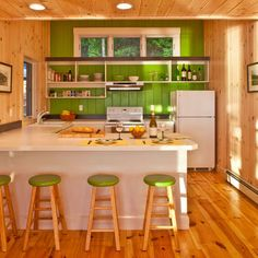 cottage kitchen with bright green accent wall  I was looking at the contrast of a color wall against other neutral walls.