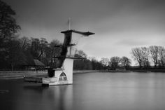 Forgotten Past-times by Ian Kelsall on 500px     The old diving tower at a municipal park in the town of Swindon, UK. Built in the 1930's, it now stands as an Art Deco relic used only by the birds. #art deco #black and white #derelict #dive #lake #long exposure #reflection #swindon #unused