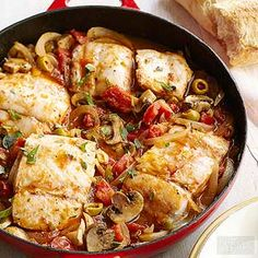 Mild-flavored fish takes on an amazingly savory quality once simmered in a skillet of mushrooms, tomatoes, onions, and olives.