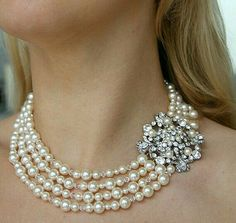 Instead of beads have a smaller pearls in between the large ones.