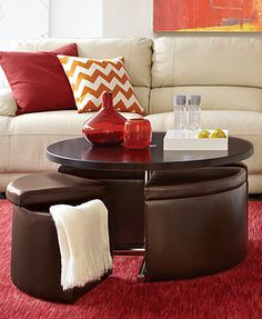 At Macy's on sale for $439 end of Jan.  Neptune Coffee Table with Storage Ottomans. Top lifts up - nice dual-function piece.