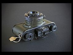 U.S. Army Signal Corps PH-324 Kodak 35 rangefinder camera without the leather case and neck strap. Viewfinder popped up on top of camera.