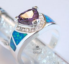 6,7,8,9,10 Stunning blue topaz and fire opal ring. Starting at $10 on Tophatter.com!