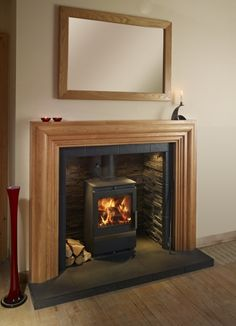 1000 images about fireplace on pinterest wood burning for Cheap wooden fireplace surrounds