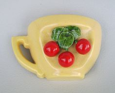 Vintage wallpocket by Covina Pottery yellow tea cup with cherries.