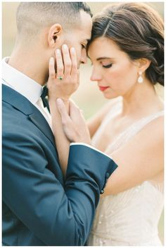 Romantic bride and groom. Wedding dress by Amsale with ring by Claire Pettibone for Trumpet & Horn. Image by Elizabeth Fogarty.