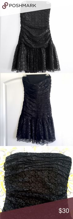 Betsy Johnson Lace Strapless Dress This is a unique little black dress - great for girls who have curves. I never wore it because I have a straight figure and because it was a little too big. (It's size 10.) The lace is shimmery - I tried to capture that in the pictures, and it has a side zipper. The folds at the top are not symmetrical, (see close up of top) but It came that way when purchased, so think that's the way it's supposed to be. A roommate of mine wore this once to a sorority…