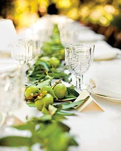 At Claire and Benjamin's outdoor wedding in Beverly Hills, nearly 1,000 feet of California bay laurel garlands ran along the house, the yard, and down the tables' centers; persimmons, figs, raspberry branches, and passionfruit vine punctuated the garlands.