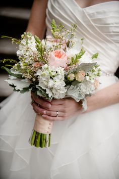 elegant vintage bouquet with juliet garden roses, stocks, snowball mums, wax flowers, snapdragon, and dusty miller. Designed by Garden Party Flowers and photographed by Erin Gilmore