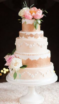 Featured Cake: Sweet Fix RVA; Chic white and gold flower topped wedding cake