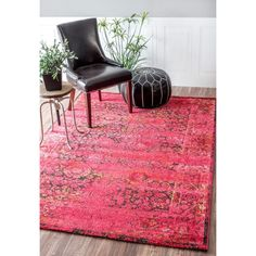 This machine-made 100-percent polypropylene rug features a traditional style with a modern color palette. Constructed in a durable yet soft polypropylene construction this beautiful rug will make a wonderful addition to any room.
