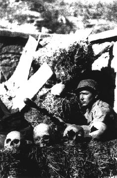Brazilian sniper in a cemetery preparing to ambush, Gothic Line-North of Italy, 1944. Note the grenade on his rifle.