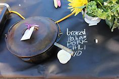 chalk on black kraft paper to label dishes at a cookoff    Wine Sisterhood sponsored bocce chili cookoff - at helenjane.com