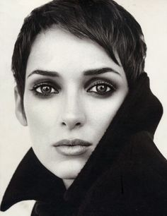 Short cut, beautiful eyes and make-up. Winona Ryder looks fragile and strong.