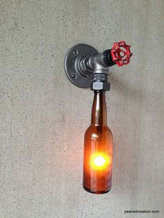 DIY Industrial Beer Bottle Pipe Sconce Lamp, Great Decor Idea for a Bar.  Visit www.ilikethatlamp.com for more DIY lamp inspiration and tutorials.