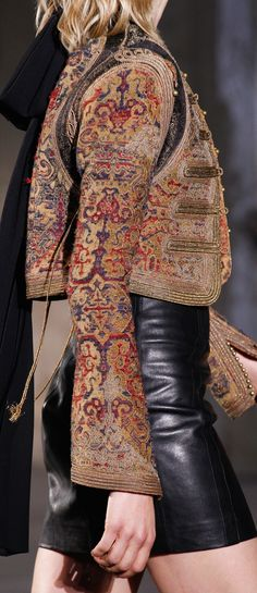 Saint Laurent S-17 RTW: tapestry military jacket, leather skirt.