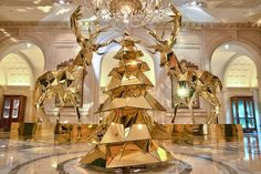 Electric Light Bulb Christmas Tree and Gold Reindeer in Paris - My Modern Met Jeff Leatham Christmas Windows, Indoor Christmas Lights, Christmas In Paris, Noel Christmas, Christmas Staircase, Xmas Lights, Reindeer Christmas, Magical Christmas, Modern Christmas