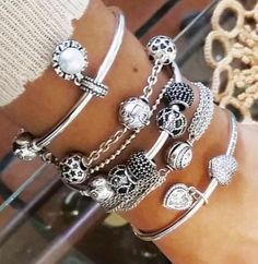Who could afford so many Pandora bangles with the charms must be super expensive