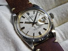 Rolex date just ref. 1601 with silver linen dial on brown leather strap.